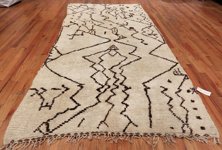 Magnificent tribal Vintage Moroccan rug, country of origin / rug type: Morocco, circa date: Mid–20th century. Size: 5 ft 5 in x 12 ft 3 in (1.65 m x 3.73 m)  This mid century vintage  Moroccan tribal rug has an appeal that developed long before the