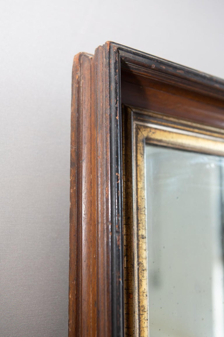 19th century American mirror with antique glass and distressed gilt trim. Frame shows it's age with losses to gilt and beading but still has an amazing presence. Mirror/glass has a beautiful patina.