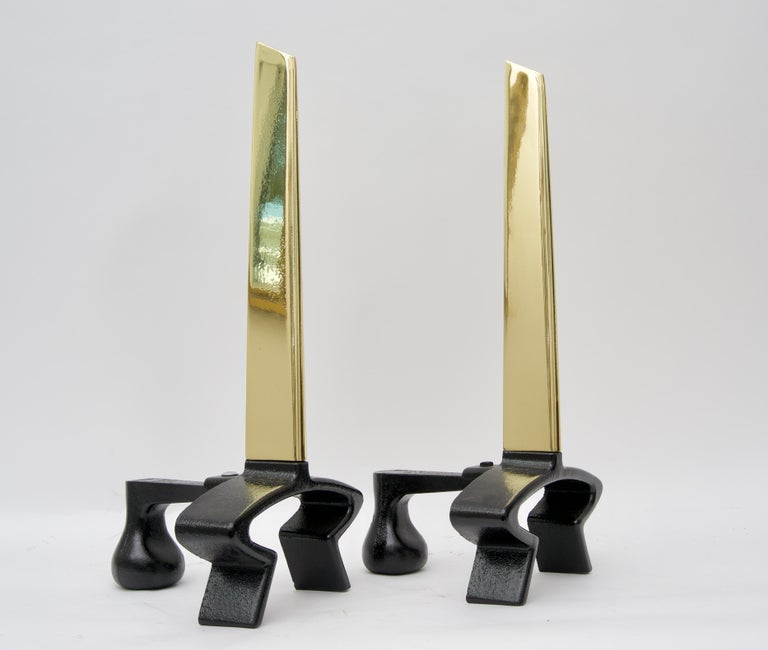 This stylish Mid-Century Modern set of andirons in polished brass and black iron date to the 1950s and have been professionally polished and will make a great look for your fires this winter season.