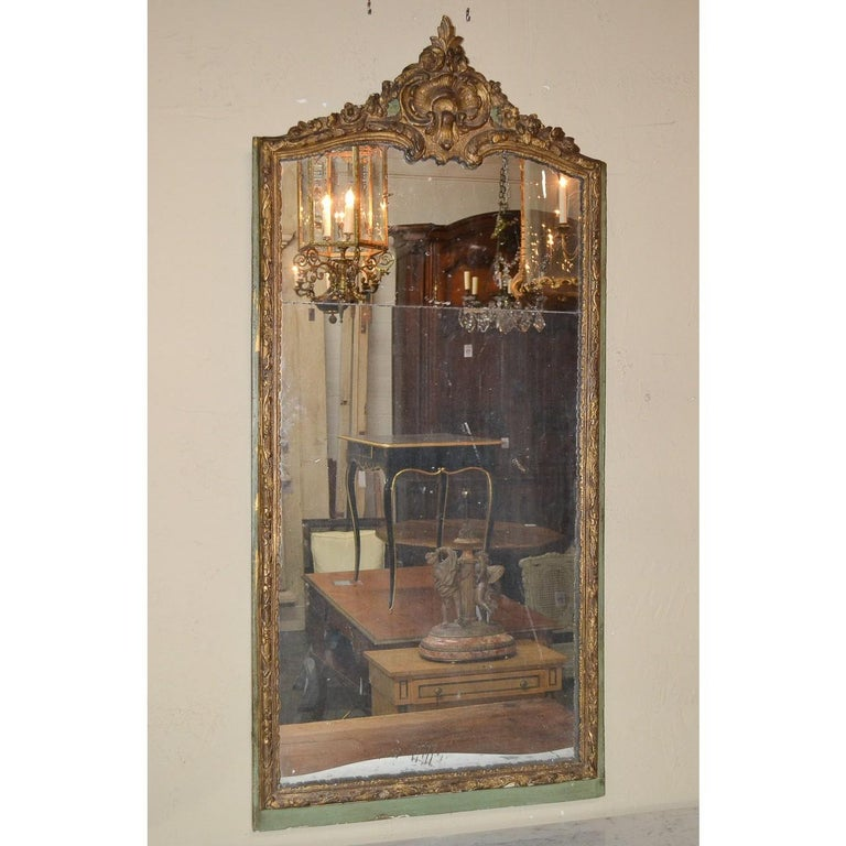 Carved 18th Century French Regence Parcel Gilt Mirror For Sale
