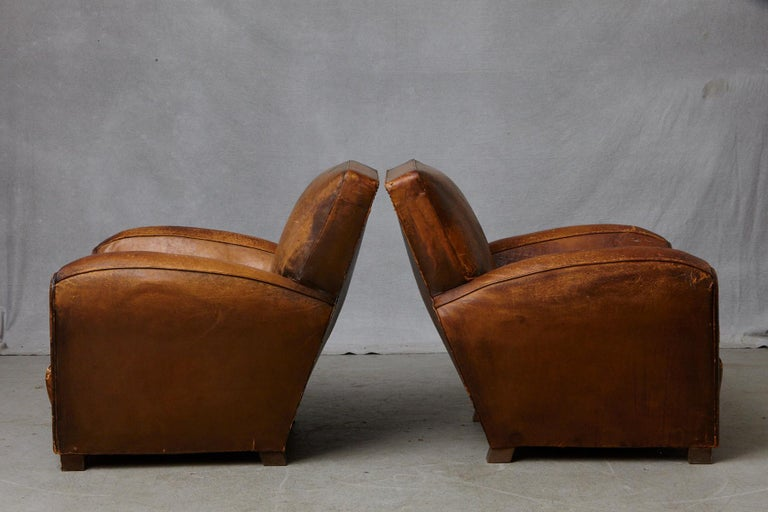 Pair of Large Distressed French Leather Fauteuils or Club Chairs, circa 1930s In Distressed Condition For Sale In Weston, CT