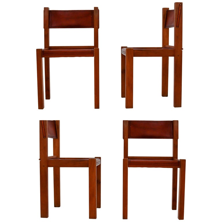 Four Midcentury Wood and Leather Dining Chairs For Sale