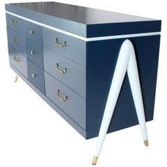 White and Blue Exposed Sculptural Compass Shape Legs Nine Drawers Dresser