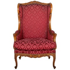 French Carved Walnut Wingback Armchair