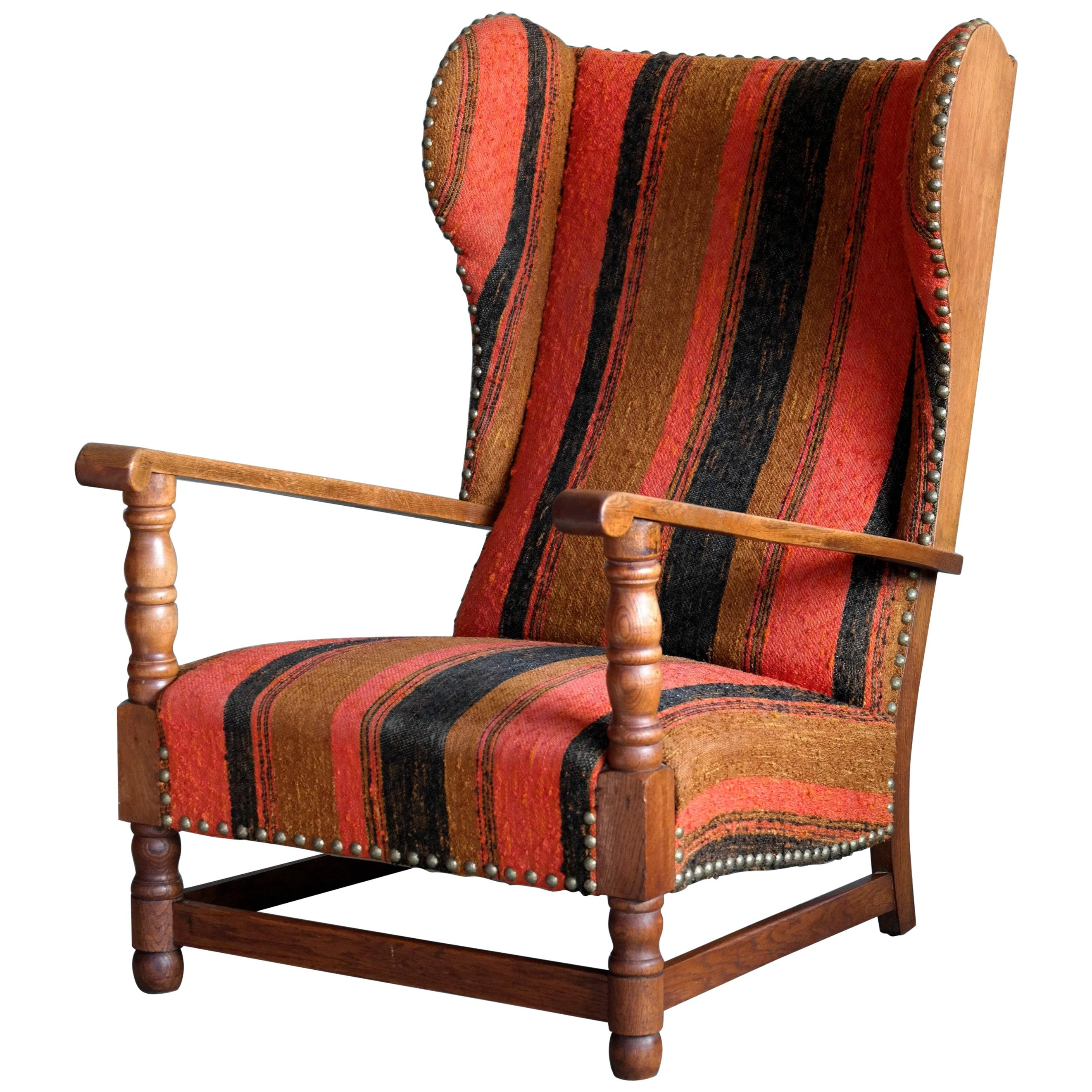 Danish 1930s Midcentury Country Style Wingback Armchair In Solid Oak For  Sale