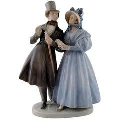 "Large Royal Copenhagen Figurine, ""Evening walk in Tivoli gardens"""