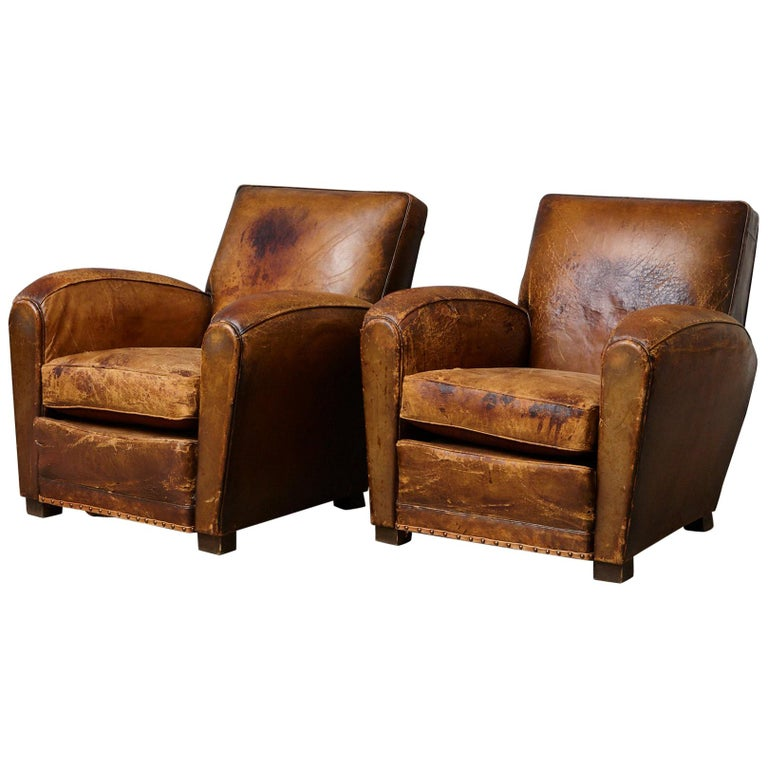 Pair of Large Distressed French Leather Fauteuils or Club Chairs, circa 1930s For Sale