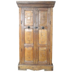 Indian Vintage Wooden Armoire with Hand-Carved Radiating Sun Motifs