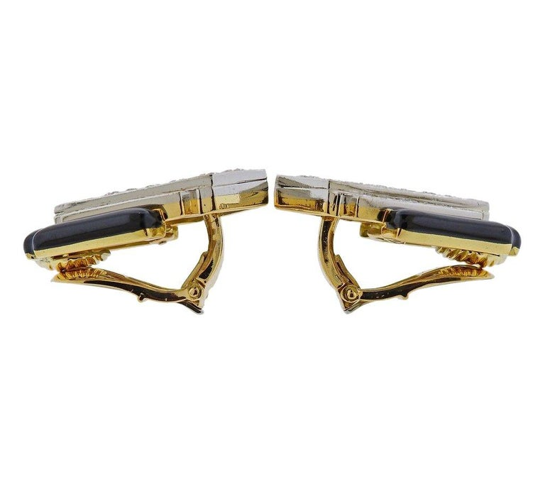 Pair of 18k gold and platinum David Webb earrings, featuring black enamel and approx. 3.00ctw in H/VS diamonds. Earrings are 28mm x 22mm. Weight is 25.7 grams. Marked Webb, Plat 18k.