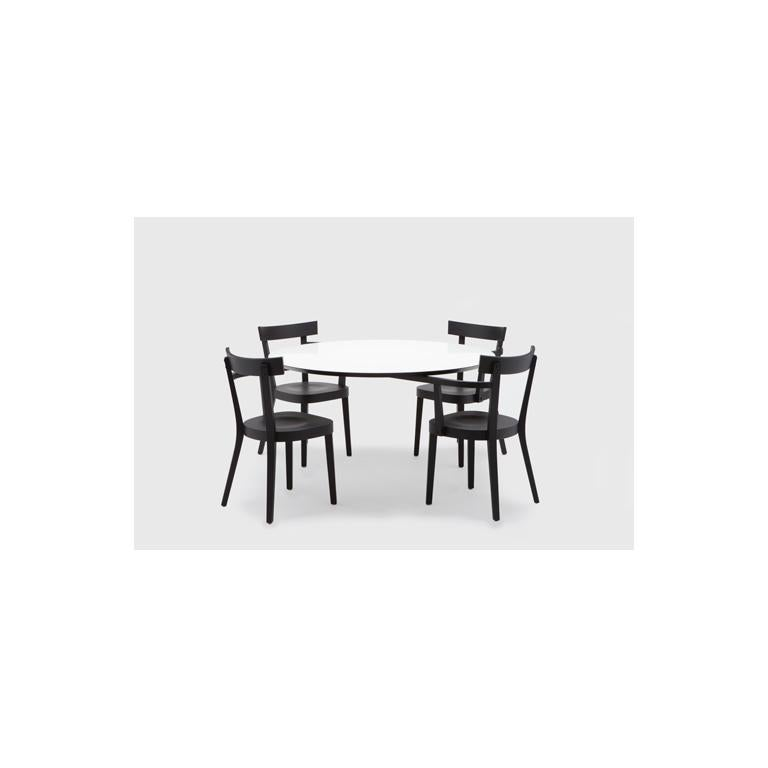 This innovative piece is the first production table from the widely celebrated designer, Ingo Maurer. On first inspection, it appears to be an archetypal wooden kitchen table and chairs but on closer viewing the table is revealed as 'floating';
