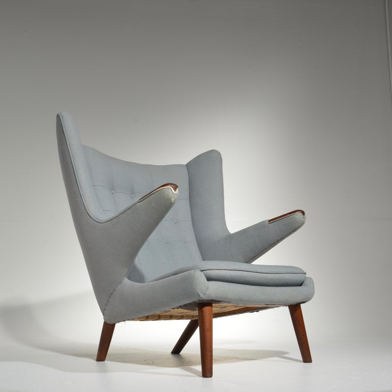 This is an early papa bear chair with the original upholstery.