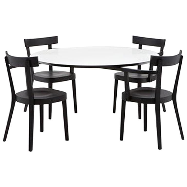 Elished Sons White Floating Table With Four Black Chairs By Ingo Maurer For