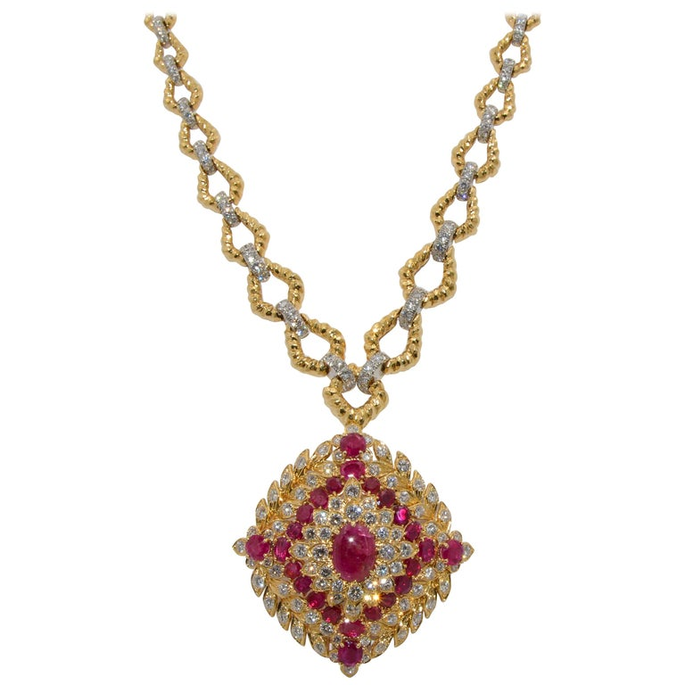 The necklace is 18K yellow gold with an 11 link hammered finish. Each hammered link is set with 7.25 ctw (approximate) round brilliant cut diamonds set in platinum. The brooch is 18K yellow gold and platinum with 5.90ctw cabochon cut ruby as the