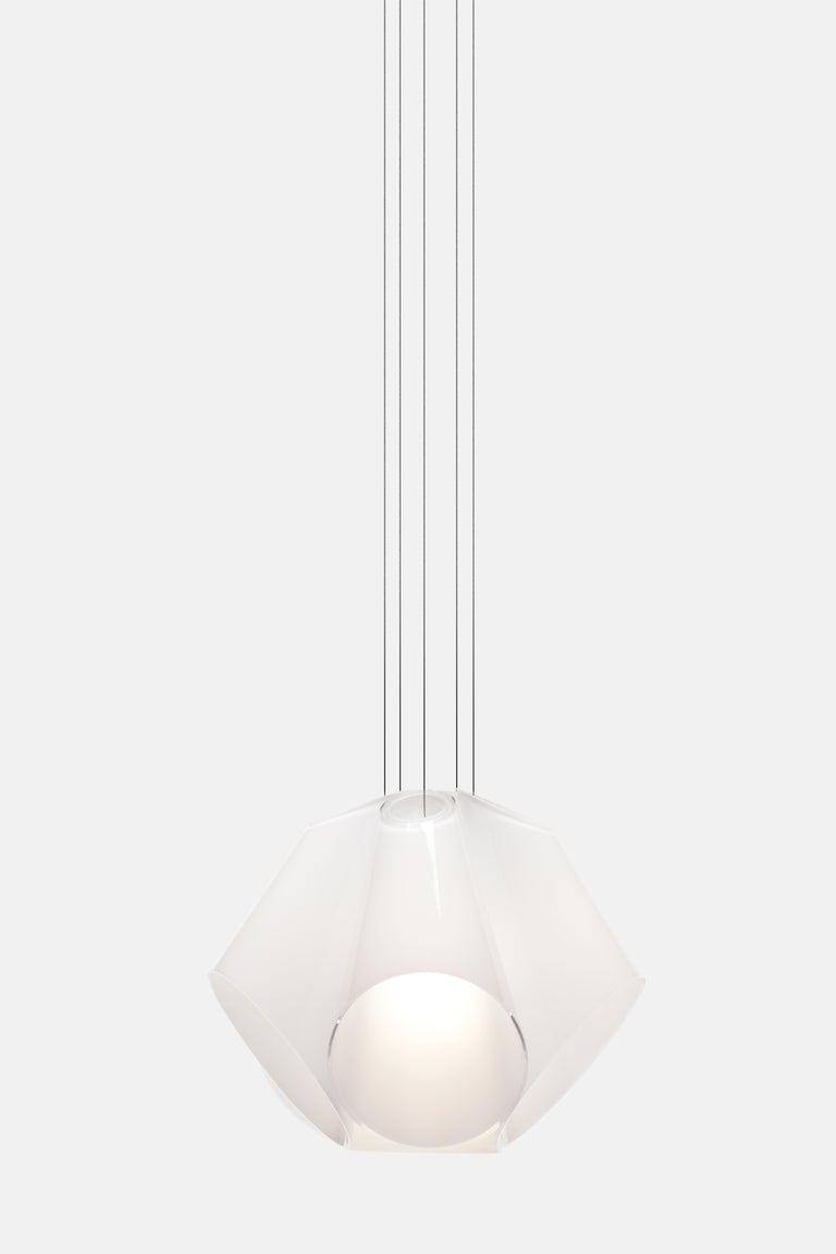 The Super Conic pendant light not only reveals details of the area it illuminates, it also adds its own delicate beauty to its surroundings. Made from a bouquet of white glass cones arranged around a light diffusing cone in the centre, the light