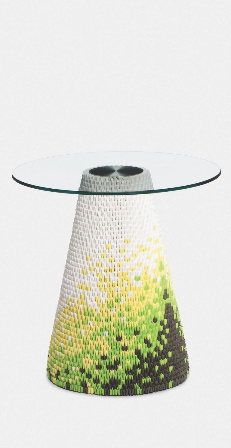 These remarkable glass topped tables utilize a unique and ancient oriental process of interlocking folded paper. Individual paper components knitted together form the table base and create engaging visual patterns and textures whilst also providing