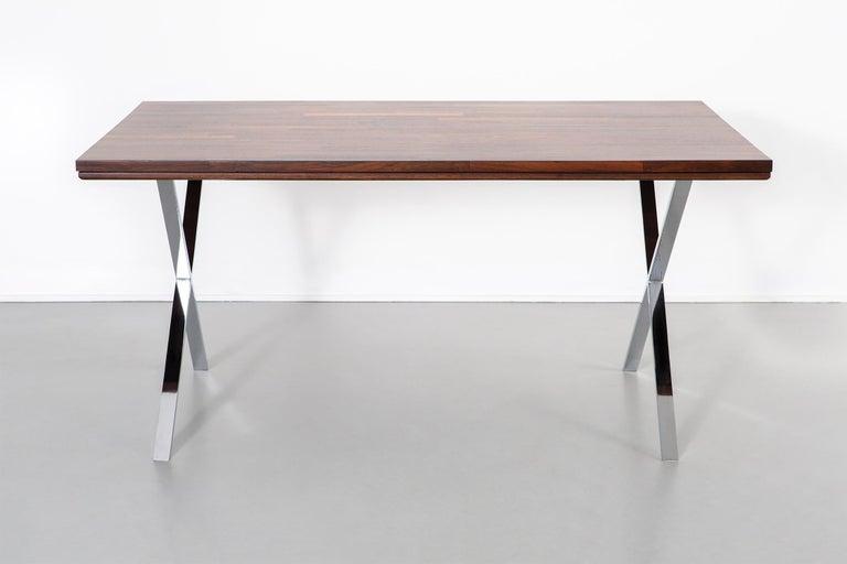 "Campaign desk.  Designed by Milo Baughman.  USA, circa 1970s.  Rosewood and chrome.  Measures: 29 ¾"" H x 60"" W x 35 ¾"" D."