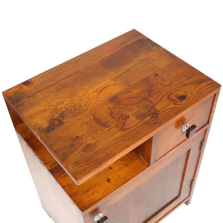 Tyrolean nightstand period Art Deco in massive larch, polished to wax with handles in bakelite, original of the time  Measures cm: H 65, W 49, D 37.