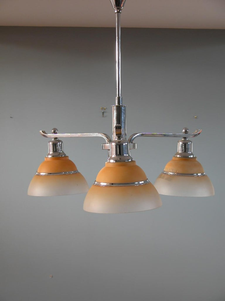 Fog & Mørup, early Danish chandelier with three arms, chrome and yellow / orange frosted glass shades, origin: Denmark, circa 1930 - 1940.  Fog & Mørup was a Danish lighting company founded in 1815 in Copenhagen, Denmark by Ansgar Fog and E Mørup;