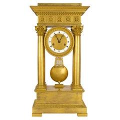 French Mid-19th Century Empire Style Ormolu Clock, Signed Petit a Paris