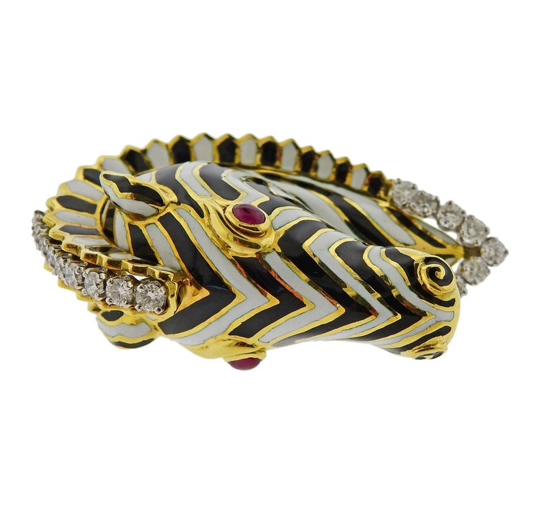 18k gold and platinum zebra brooch by David Webb, set with ruby cabochon eyes and approx. 1.00ctw in diamonds. The brooch measures 52mm x 33mm . marked David Webb, 18k, 900 PT. Weighs 45.7 grams.   SKU#PB-03023