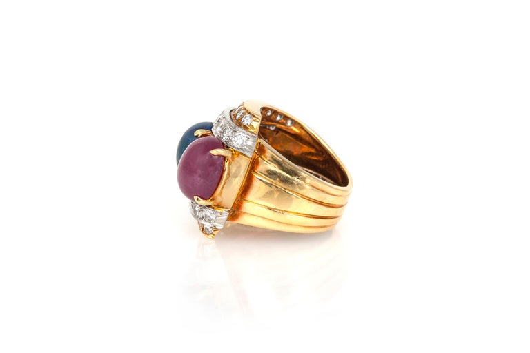 David Webb ring, finely crafted in 18k yellow gold and platinum with diamonds weighing approximately a total of 2.03 carats, cabochon ruby weighing a total of 5.71 carats, cabochon sapphire weighing a total of 4.94 carats and cabochon emerald