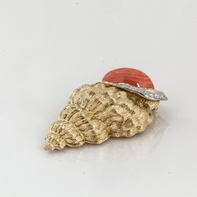 David Webb brooch depicting a shell in 18K yellow gold with coral and diamonds.  It is marked