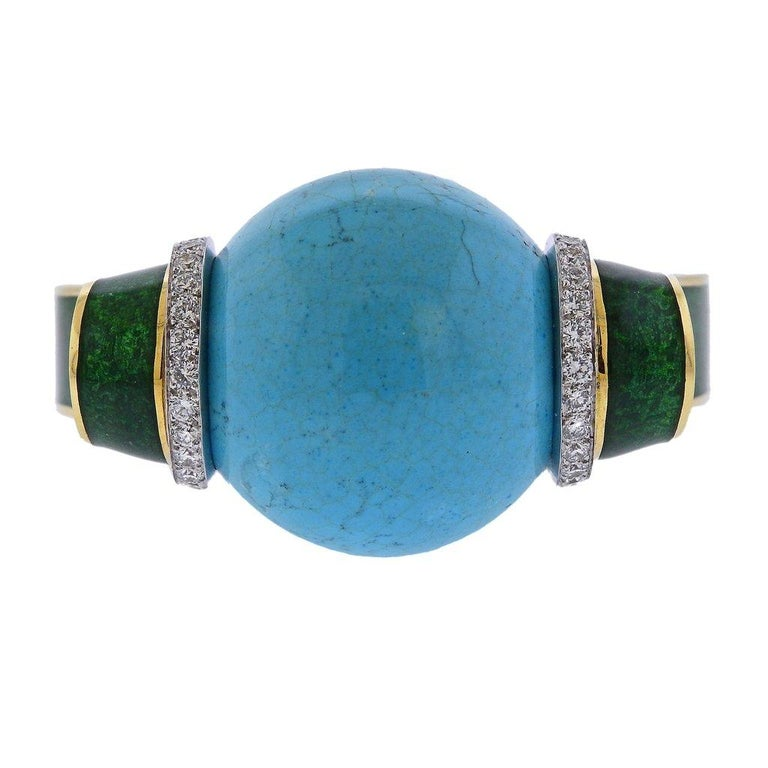 Exquisite 18k gold and platinum cuff bracelet, featuring 33mm large turquoise sphere ball, surrounded with green enamel and approx. 3.00ctw in H/VS diamonds. Designed by David Webb, retail $78000. Bracelet will fit approx. 7