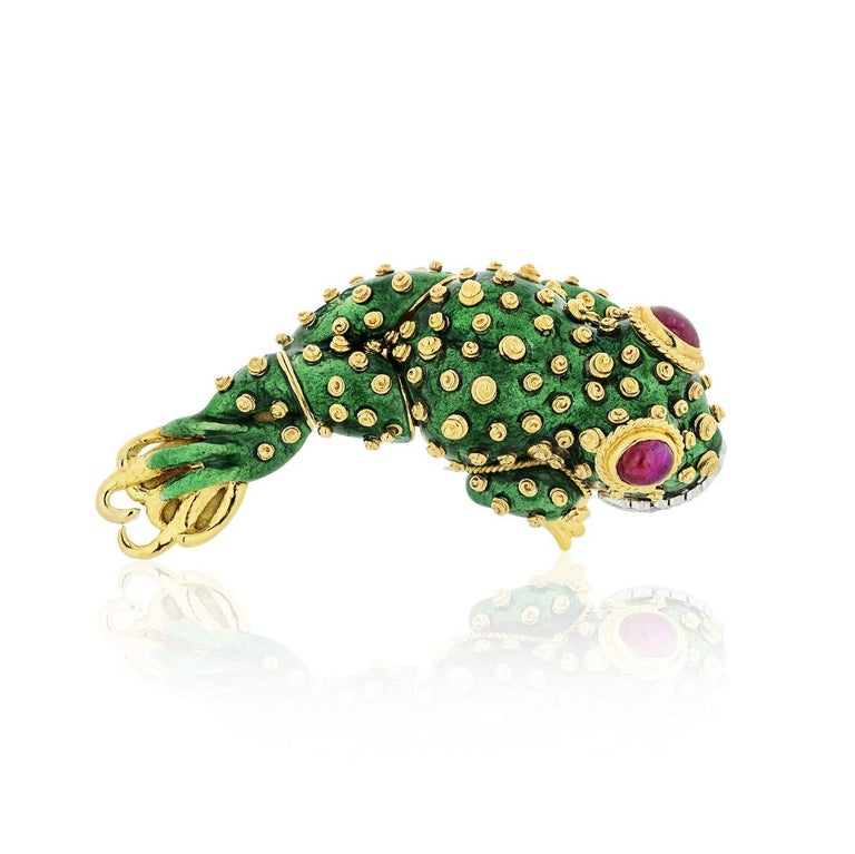 Gold, Platinum, Green Enamel, Ruby and Diamond Tadpole Brooch, David Webb 18 kt., the stylized tadpole applied with green enamel and applied gold spiral spots, with two collet-set oval cabochon ruby eyes further edged by twisted gold, its platinum