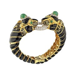 David Webb Yellow Gold Black Enamel Two-Lion Heads Emerald Kingdom Bracelet