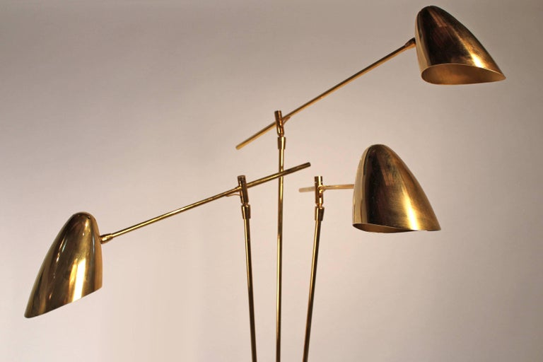 Vintage David Weeks articulated floor lamp model 303 in all brass. Lamp has been re-wired and has three pivoting bullet shades.