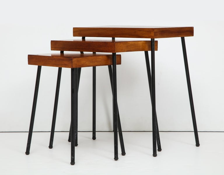 Nest of three tables with birch tops and blackened tubular steel legs. Designed by David Wurster and produced for Richards-Morgentau (Raymor) circa 1952. Wurster's lighting was a regular Good Design selection at MoMA in the early 1950's, and this