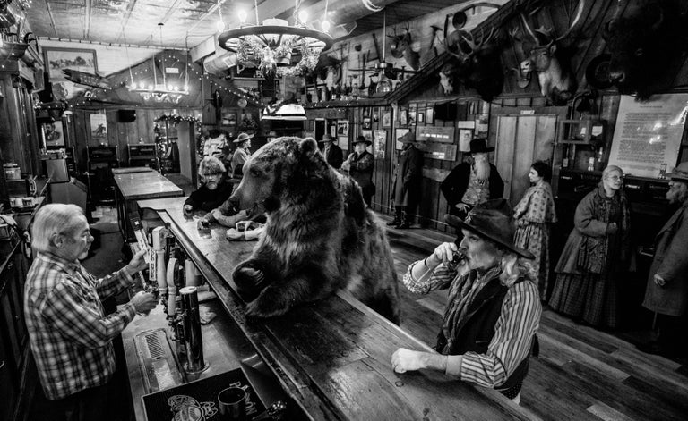 David Yarrow Black and White Photograph - Bear Walks into a Bar