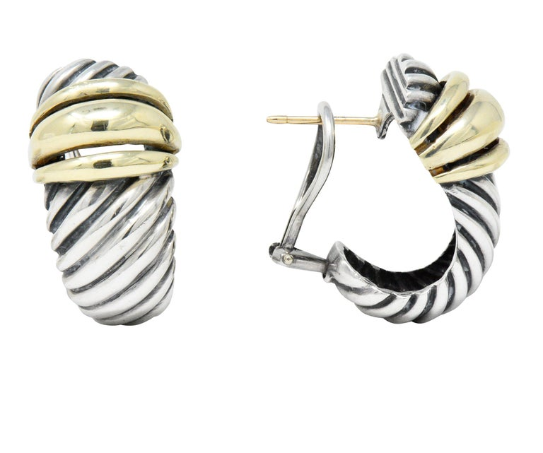 Featuring large sterling silver cable twist elongated shrimp design  Accented with bold 14k gold ribbed bands  Omega backs  Signed D. Yurman 14kt 925  Measuring 1 1/16