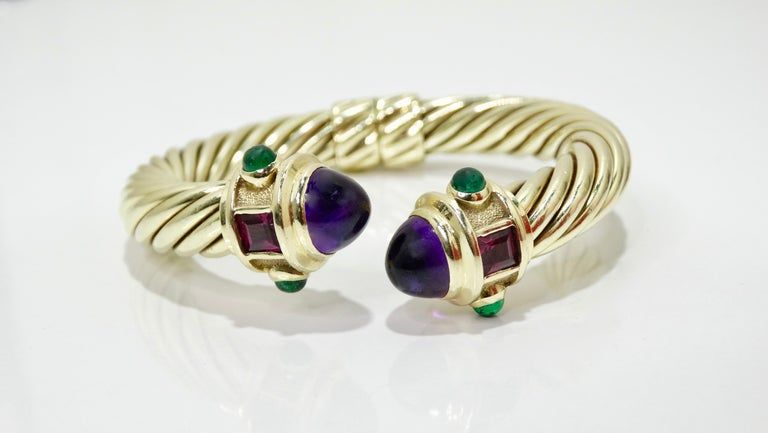 Say hello to your new favorite bracelet! Circa 1980s from David Yurman's Renaissance collection, this bracelet is crafted from 14k gold and sterling silver and features a twisted cable design with two large Cabochon Amethysts, two Tourmaline stones