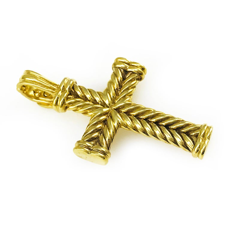 84c03c09753595 David Yurman 18k yellow gold cross pendant with opening bail. Yurman's  signature cable motif is