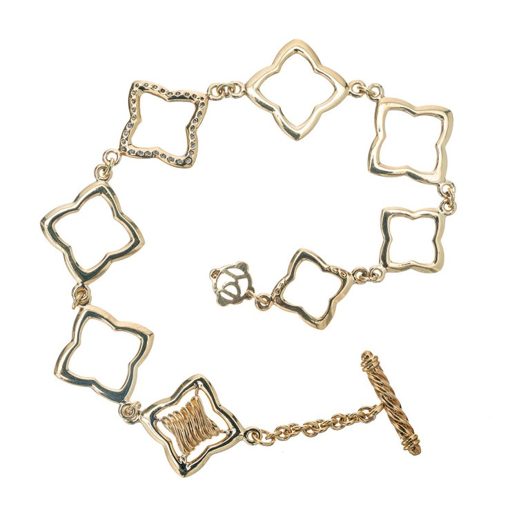 Authentic David Yurman solid 18k gold 8 link toggle diamond quatrefoil bracelet. 7.75 inches in length.   32 full cut diamonds approx. total weight .32cts, G, VS D Y tag Stamped: D Y 750 Length: 7 3/4 inches Width: 5/8 inch or 17.5mm Fits a standard