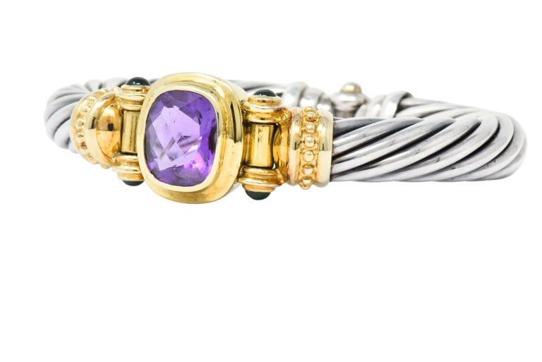 Bangle cuff style bracelet comprised of the classic twisted cable motif in silver  Centering a checkerboard cushion cut amethyst that measures approximately 15.5 x 13.5 mm; transparent and richly purple in color  Bezel set in gold and flanked by