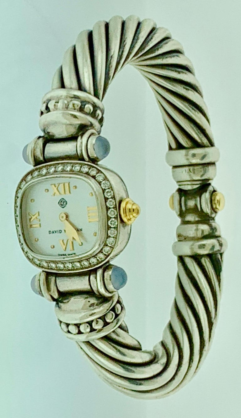 David Yurman Sterling silver and 14 K  gold cable bangle watch with diamond bezel.  54 grams. Stamped on the back