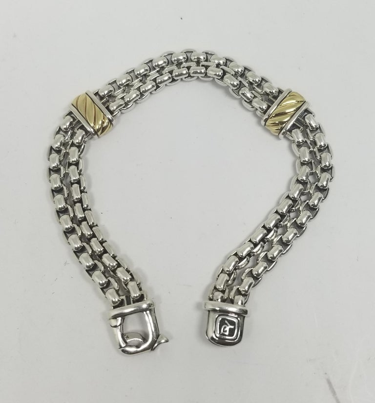 David Yurman Cable Classic Two-row Chain Bracelet with 18K Gold and Silver.  David Yurman's artistic signature, Cable began as a bracelet that he hand-twisted from 50 feet of wire. For the past 30 years, he has evolved the twisted helix into a