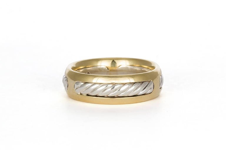 We are pleased to offer this David Yurman Cable Ring. A very stylish design from David Yurman, the four piece Cable Band will make a great gift for him that he is sure to love! This ring is crafted in sterling silver and 18k Yellow gold. It features