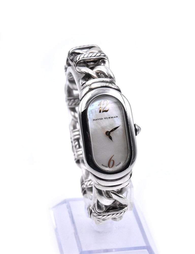 Movement: quartz Function: hours, minutes Case: stainless steel 41mm case, stainless steel fixed bezel, sapphire protective crystal, pull/push crown Band: sterling silver cable bracelet, bracelet will fit 7-inch wrist Dial: mother of pearl dial with