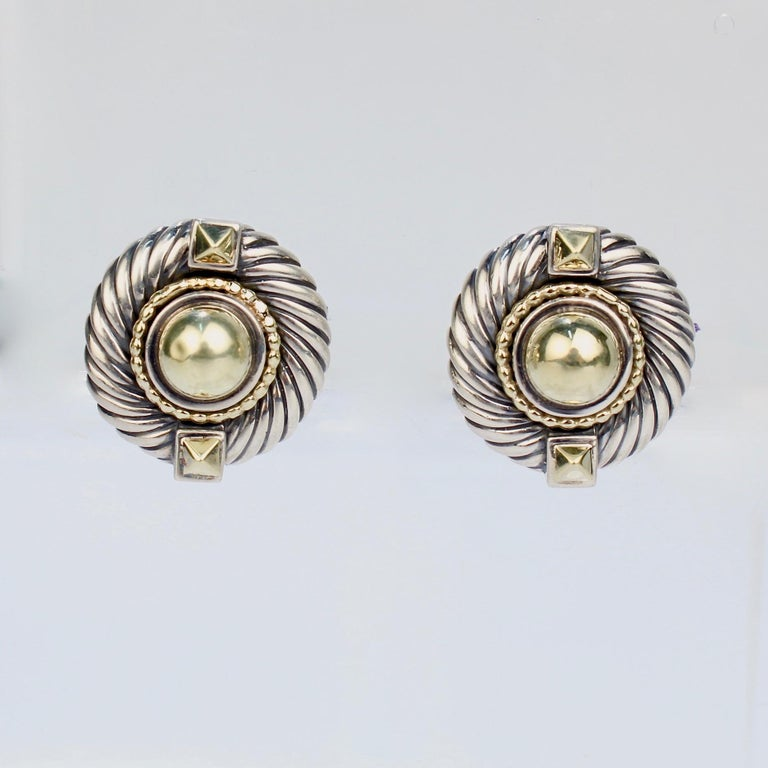 A wonderful pair of David Yurman Renaissance earrings.  Comprised of sterling silver and 14k gold. Each earring has a domed central gold cabochon flanked by two pyramid shaped buttons. The gold cabochons are framed in a beaded gold wire and Yurman's