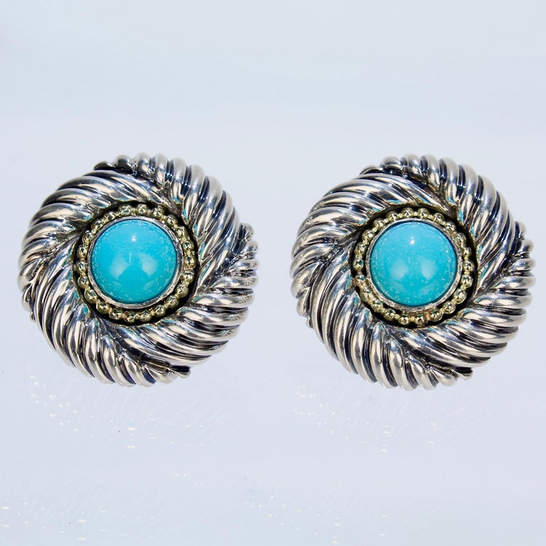 A wonderful pair of David Yurman Renaissance earrings.  Comprised of sterling silver, 14k gold, and turquoise. The turquoise cabochons are framed in a beaded gold wire and Yurman's classic Renaissance spiral design.   Fashioned with Omega clips for
