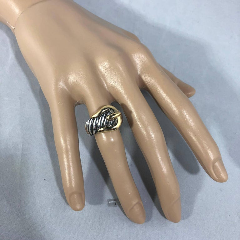 David Yurman signature cable collection buckle ring. Created in Sterling Silver and 18 Karat yellow Gold, this cable motif ring is classic and collectible. Size 6 . Metal weight ,11.2 grams / 7.2 dwt . Retail $750.00.