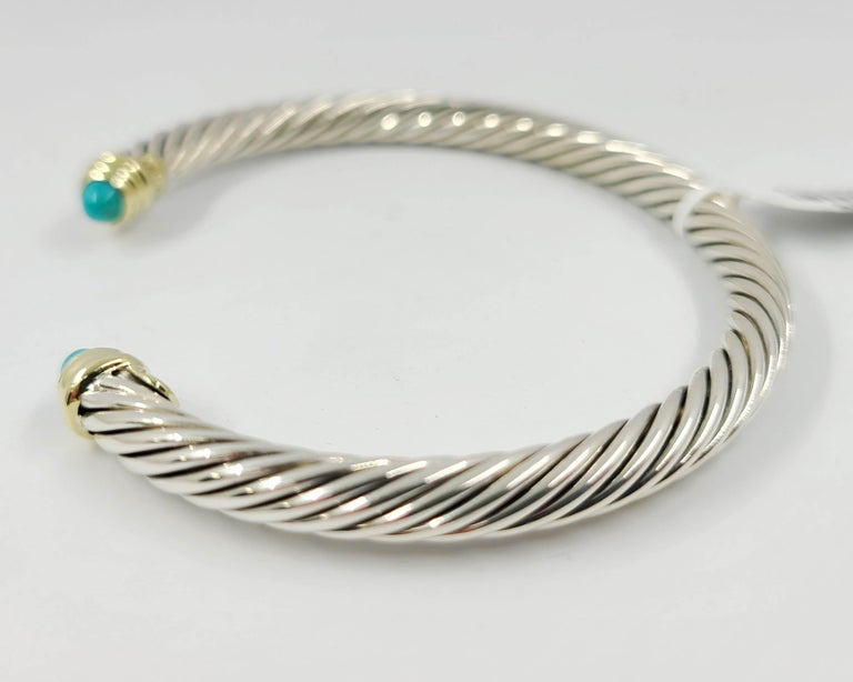Estate David Yurman 5mm Cable Cuff in Sterling Silver with 14 Karat Yellow Gold Accents & Cabochon Turquoise End Caps. Original MSRP $650.