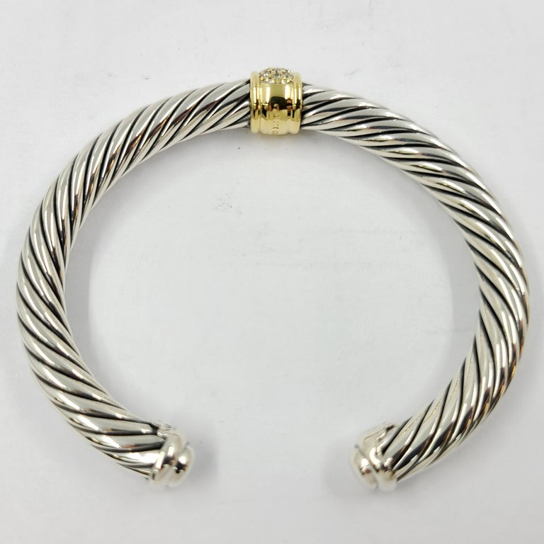 David Yurman Sterling Silver & 18 Karat Yellow Gold Wide Cable Cuff Bracelet Featuring 25 Round Diamonds Totaling Approximately 0.21 Carats. MSRP $1,700. Includes David Yurman Travel Pouch.