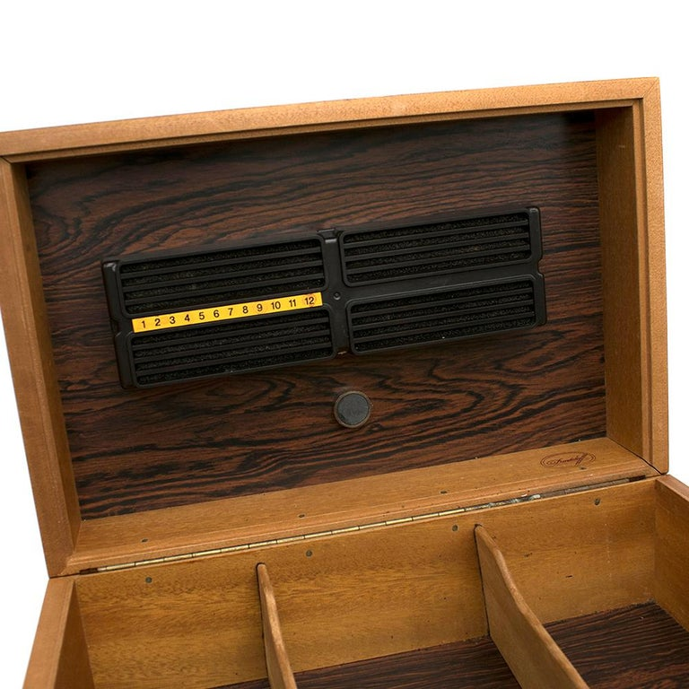 Davidoff Rose Wood Humidor  Wooden cigar box  Three sections  Bottle included Filter on the top of the box  Darker wood interior  Cigar stop on top of the box   Please note, these items are pre-owned and may show some signs of storage, even when