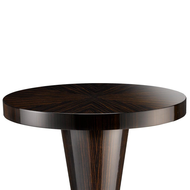 A smartly luxurious little table, the Adelaide offers the perfect finishing touch to any room setting, whether it be a hallway, office, or living room.  The table is finished in Macassar ebony, a dark, richly-coloured wood with a stripy grain,