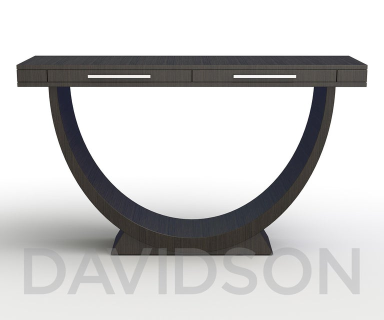 The most simple design from our range of hoop-shaped consoles, but arguably the most sleek with its slimline features. There is nothing chunky or heavy about this console with its dark finish to accentuate its form and draw they eye. We chose a