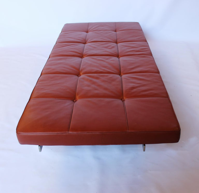 Daybed, model PK80, designed by Poul Kjærholm in 1957 and manufactured by E. Kold Christensen in the 1960s. The bed was reupholstered in cognac Classic leather circa 1998. Areas of rust on the steel frame will be polished and treated before shipping.